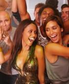 Young men and women dancing at nightclub